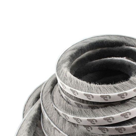 Self-adhesive wool pile weather sealing strip for windows
